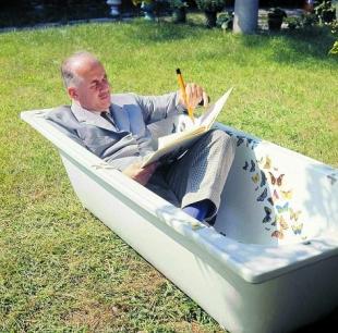 Piero Fornasetti in his bathtube, courtesy Fornasetti