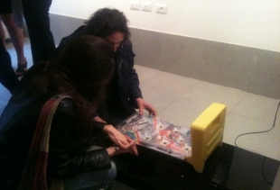 Alvise Bittente playing with his installation